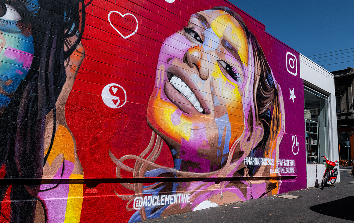A close up of the colourful mural in Melbourne, featuring AJ Clementine.