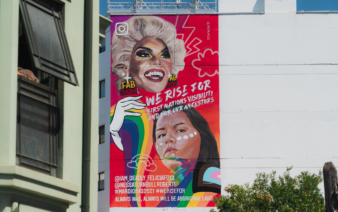 A brightly colourful mural is painted on the side of a building in Sydney feature Felicia Foxx and Nessa Turnbull Roberts