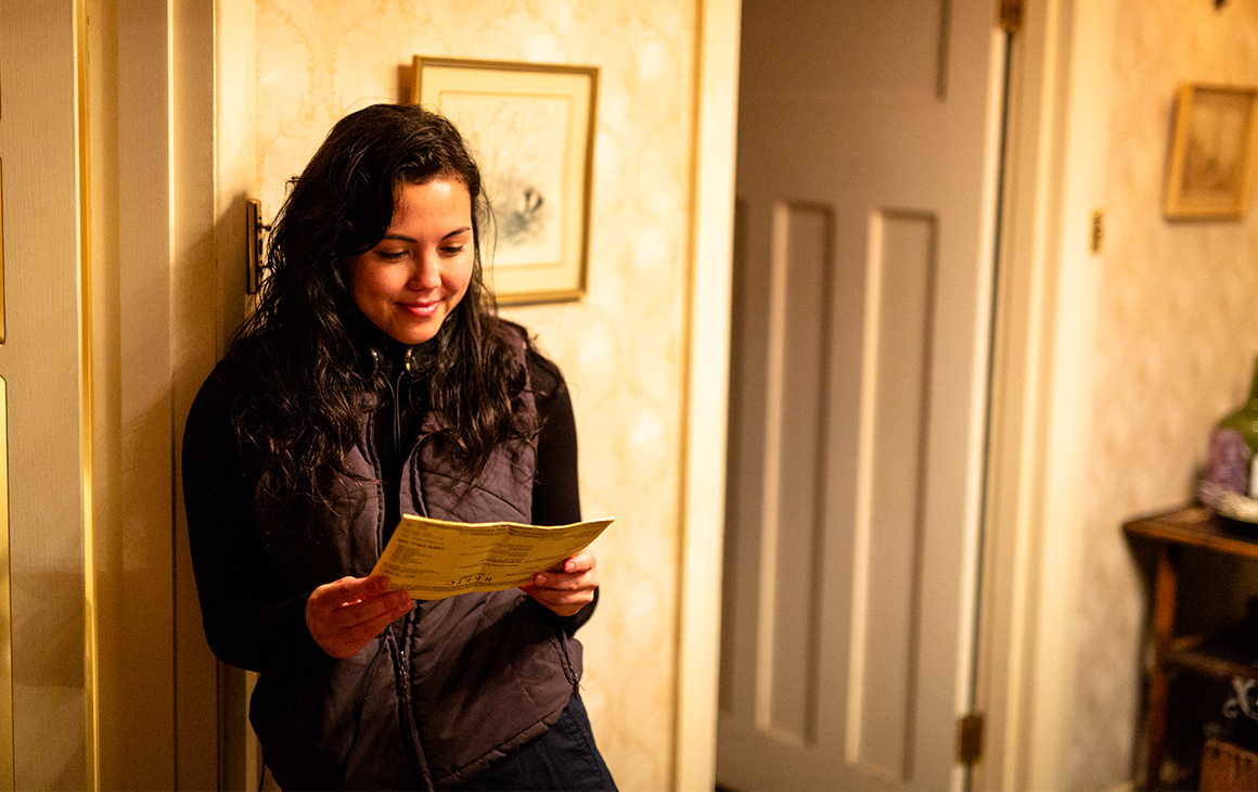 Director Natalie Erika James reads from a script on set of Relic.