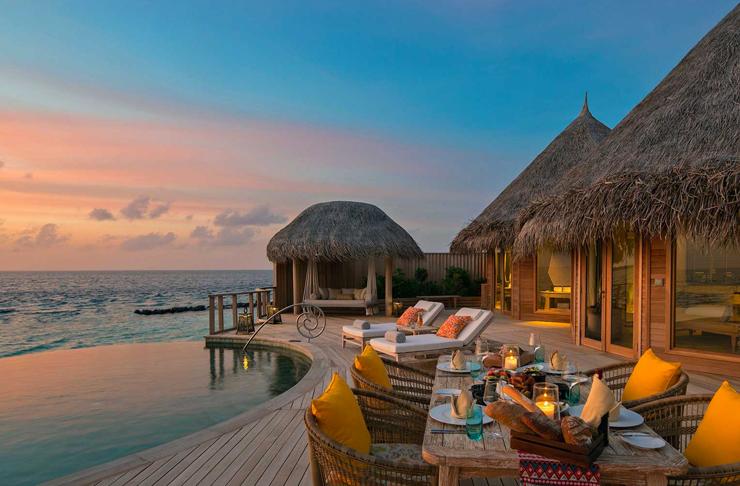 outdoor pool at sunset at the nautilus maldives
