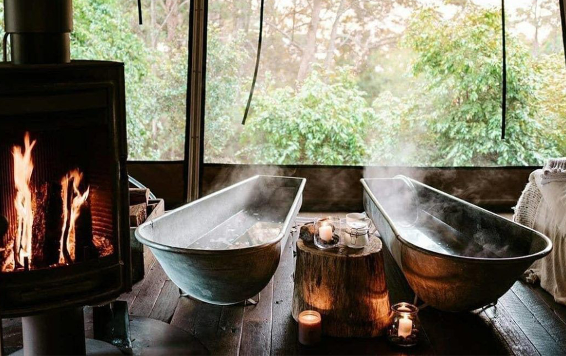 2 steaming baths next to a fire place
