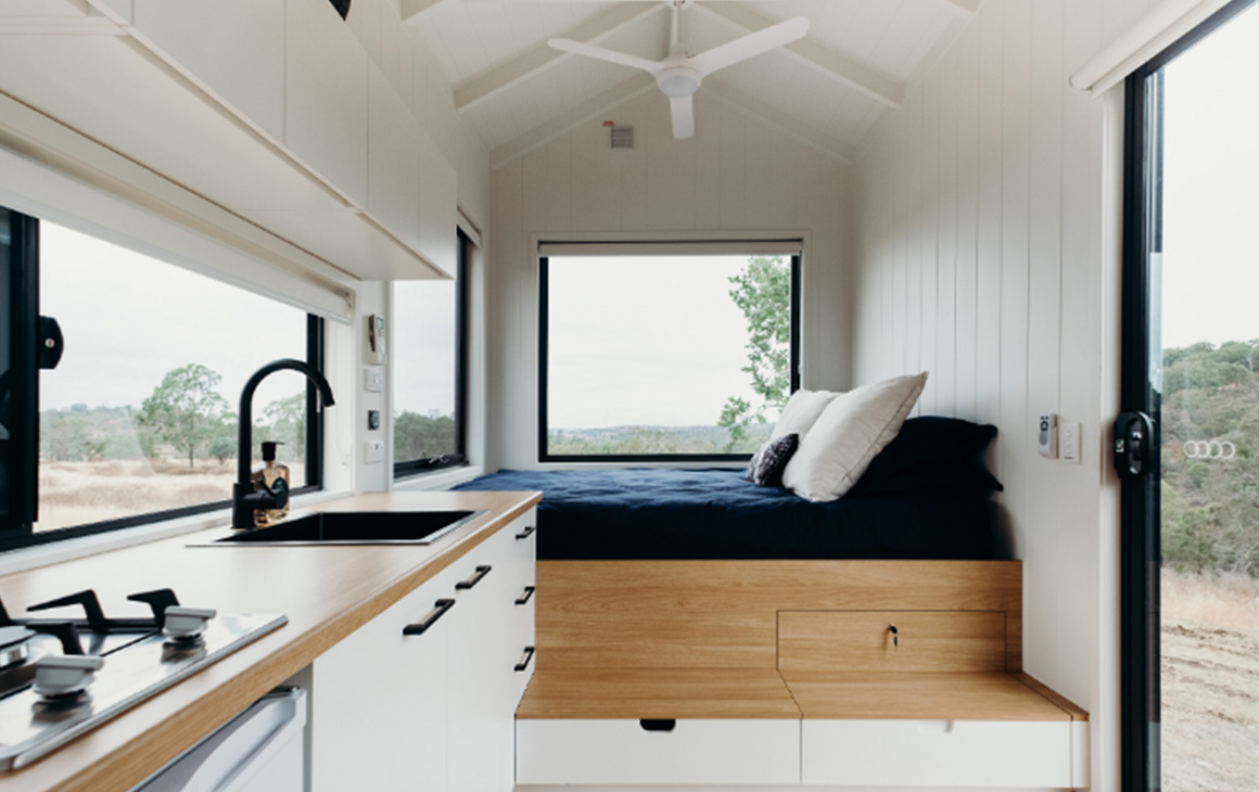 the white timber interior of Norah tiny home.