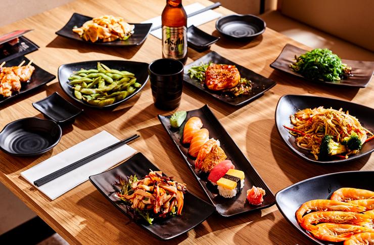 various platters of japanese food