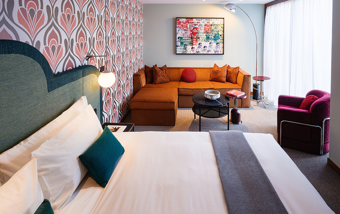 the colourful interior of a hotel room at the Ovolo South Yarra