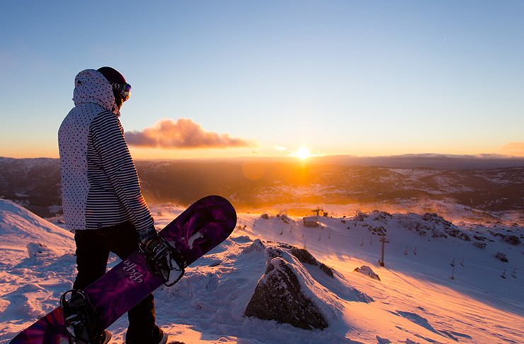 person standing on top of snowy mountain