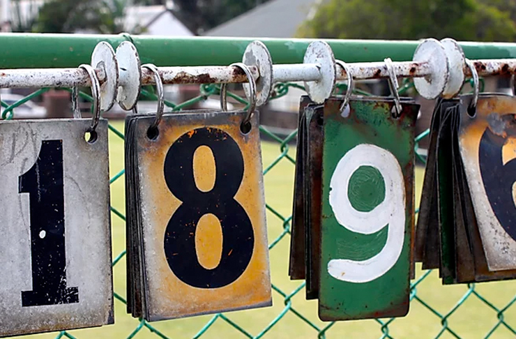 numbers hanging on fence