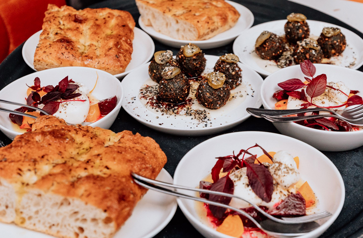 bread and mezze feast on table