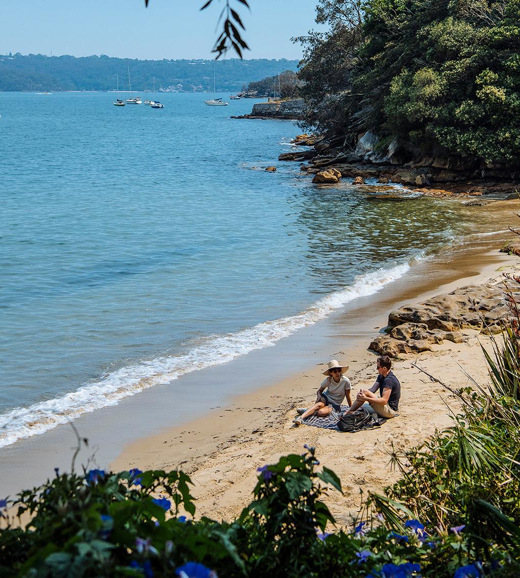 two people sitting on secret beach