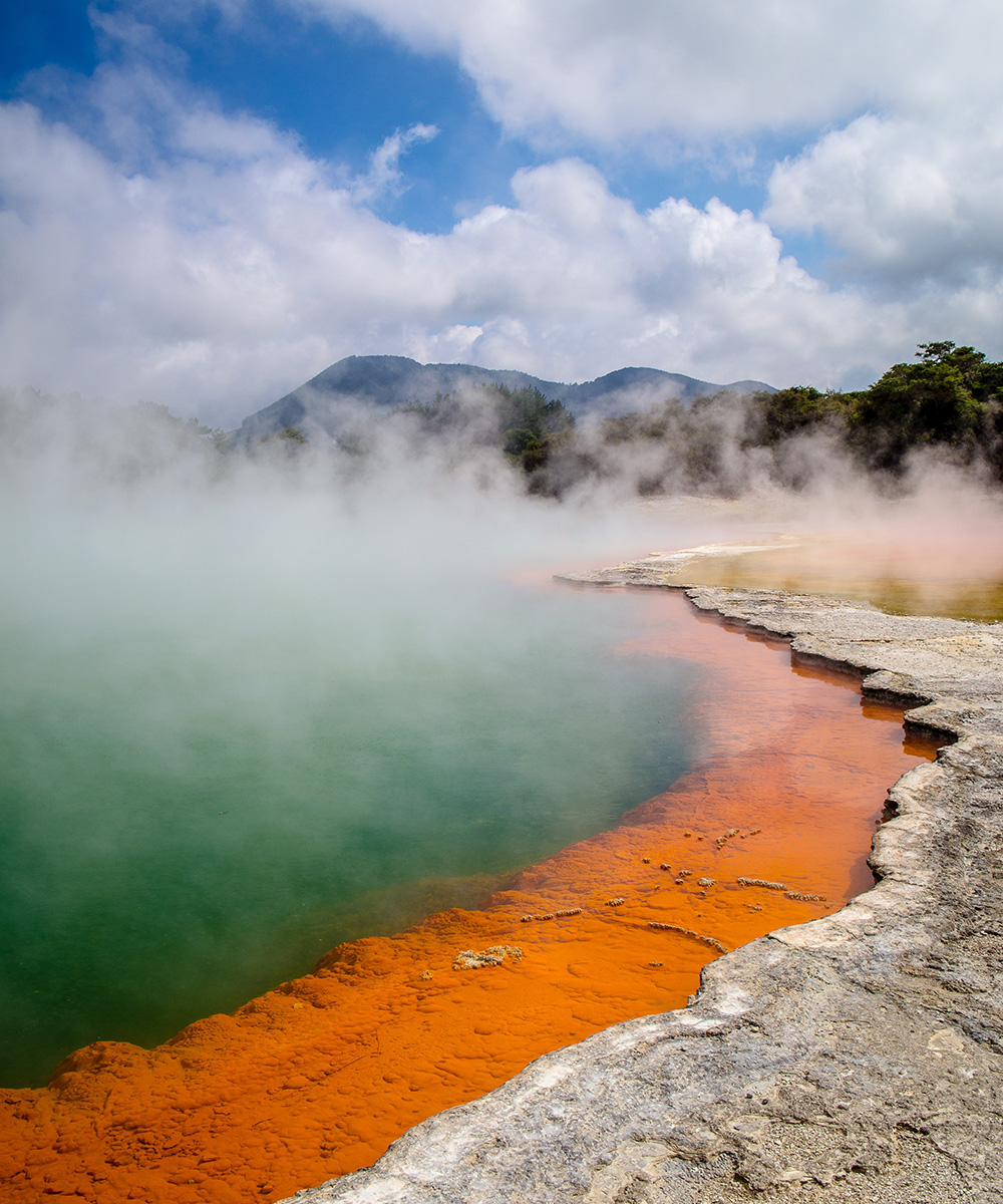 the bubbling blue waters of Rotorua on a sunny day.