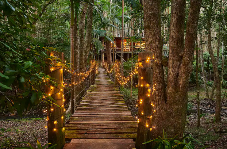 wooden bridge with fairy lights