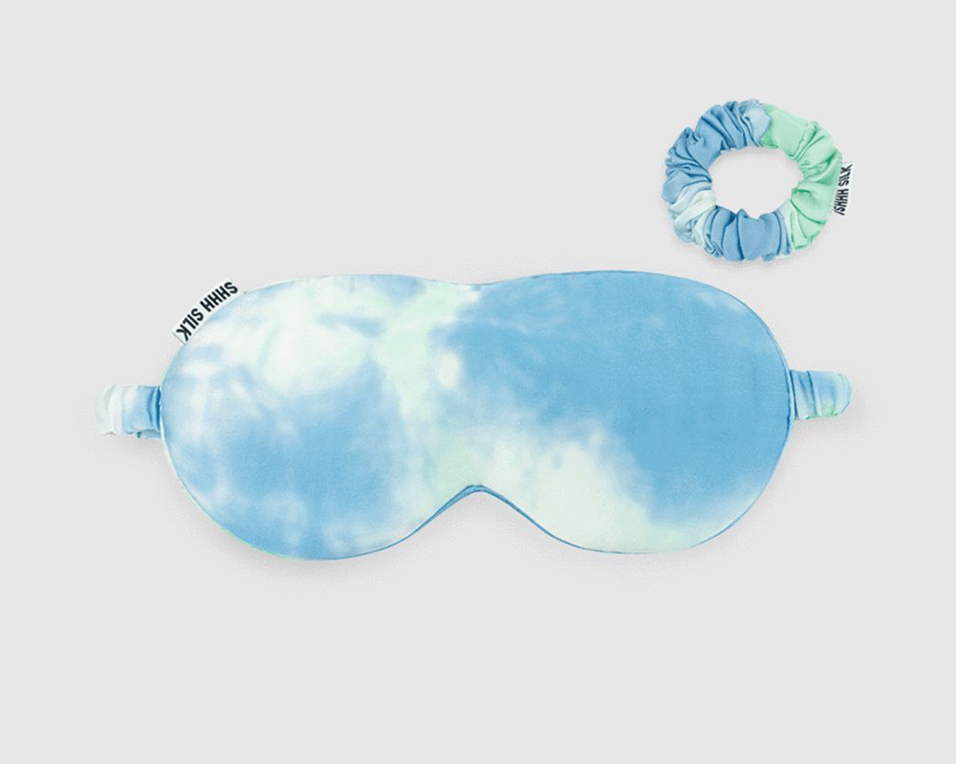 A blue tie dye eyes mask with a matching hair tye.