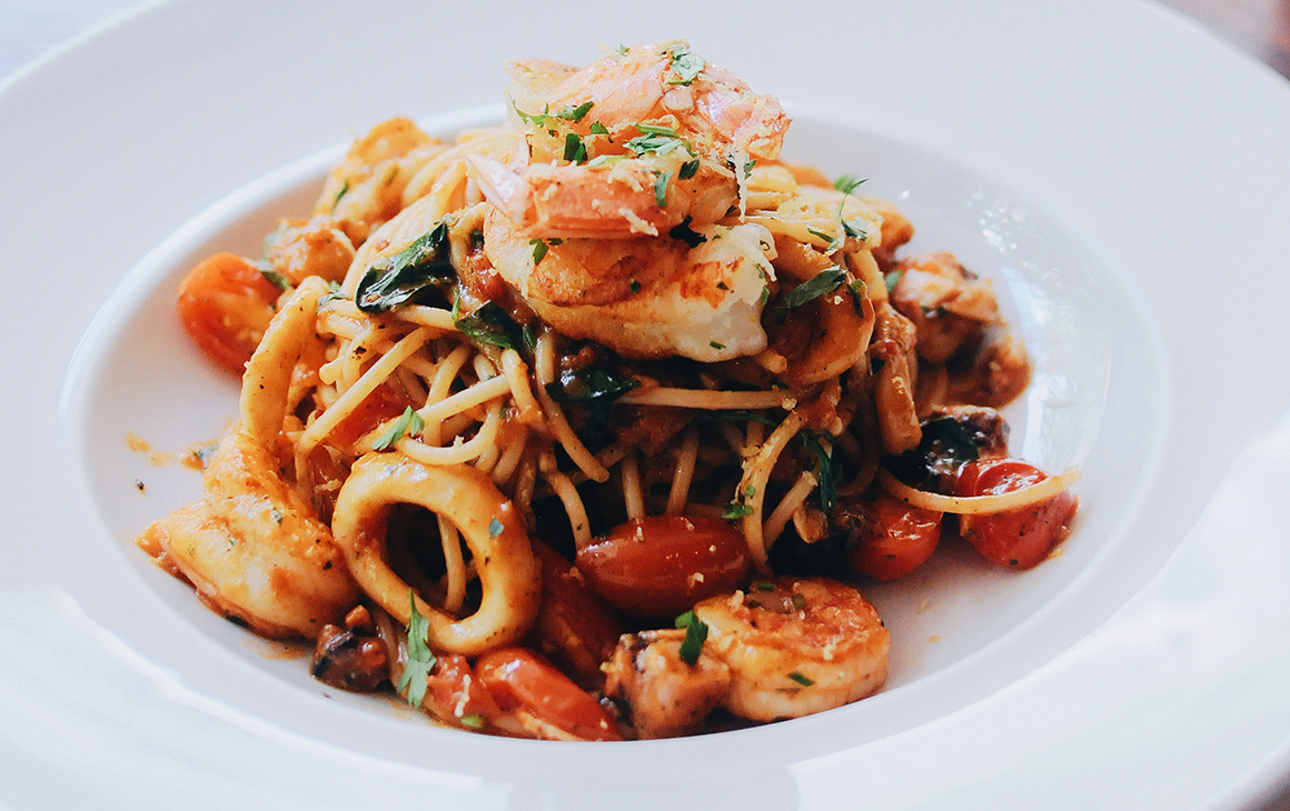 A drool-worthy bowl of seafood pasta.