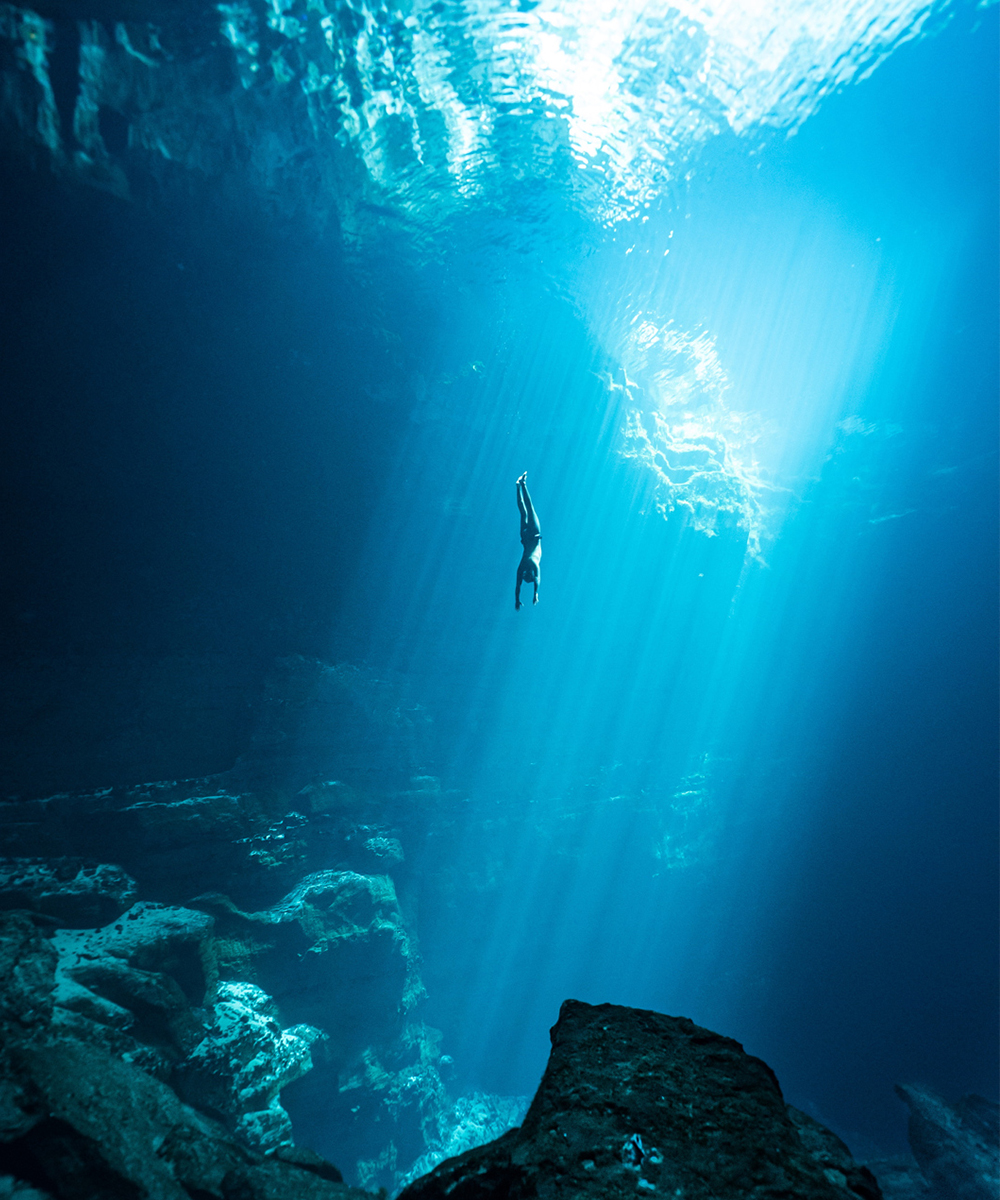 a person dives deep into the Kilsby Sinkhole