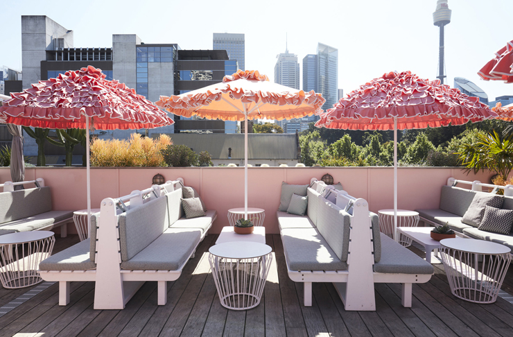 rooftop seating and old school brolly's on sydney rooftop bar