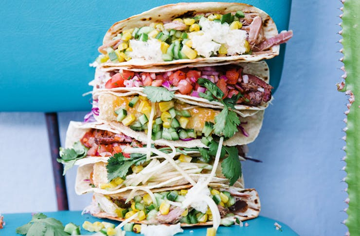 stack of overflowing tacos