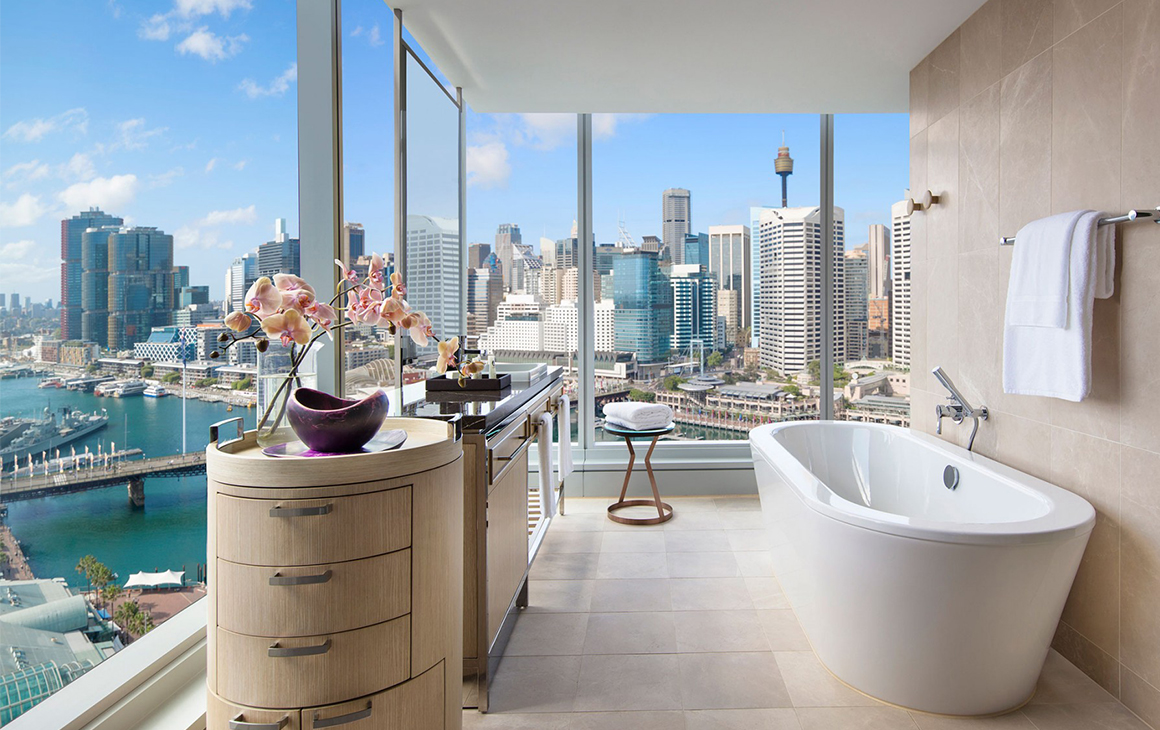 a stunning view of darling harbour from a bathroom at the sofitel