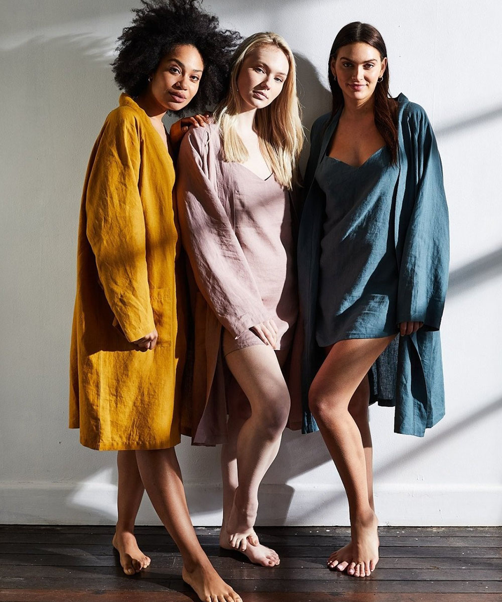 three woman pose a range of colourful linen bath robes