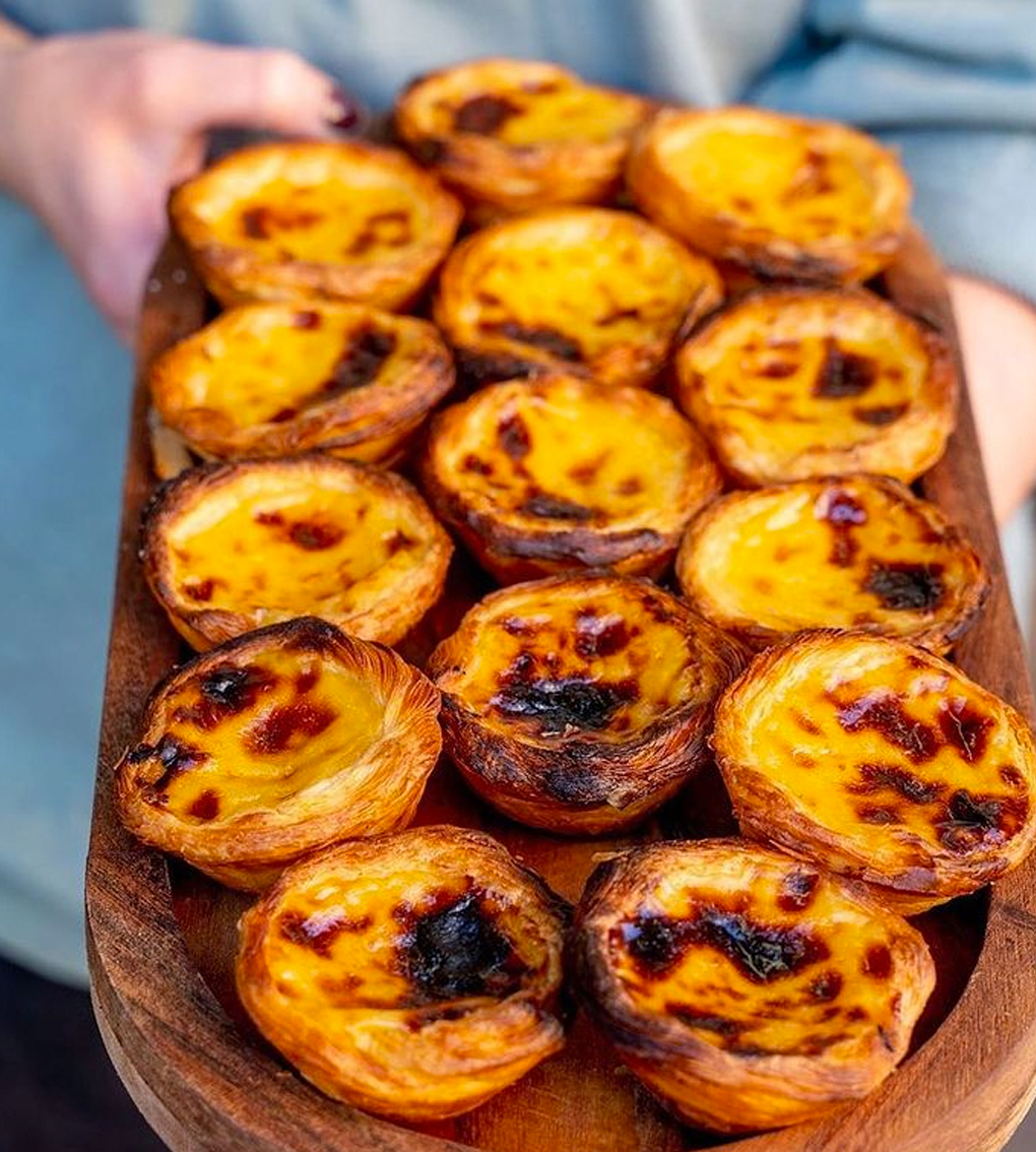 wooden tray of portuguese tarts