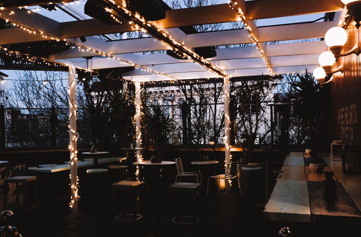 rooftop setting with exposed beams and fairy lights on pub rooftop