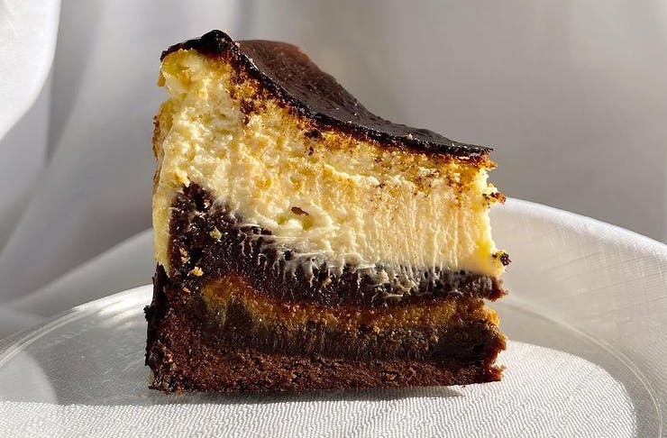 slice of burnt basque cheesecake with brownie base