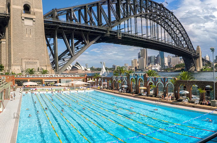 open air pool on sydney harbour in front of sydney harbour bridge