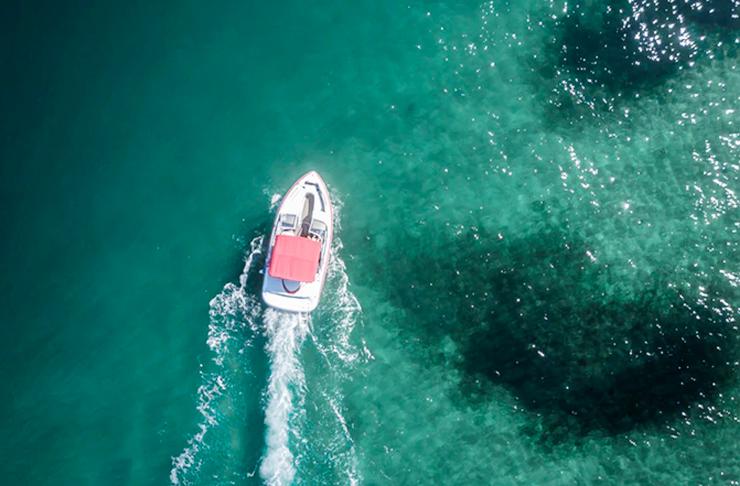 boat speeding away in water