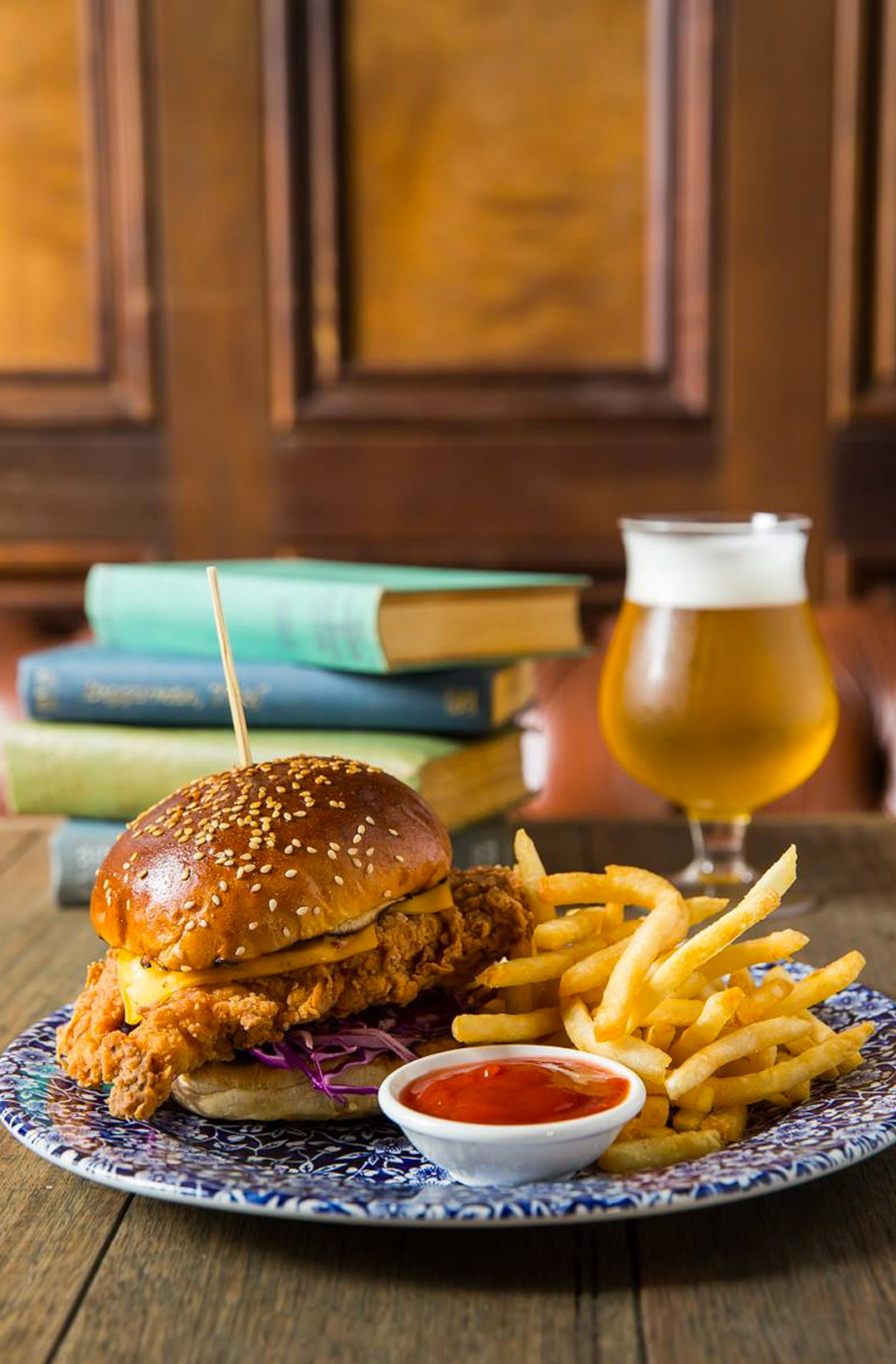 burger and beer on table