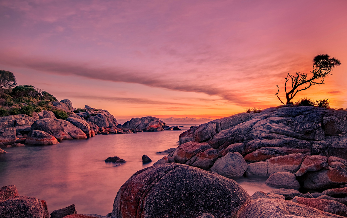 A beautiful pink and orange sunset at the Bay of Fires