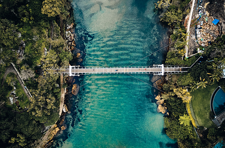 bridge going over harbour beach