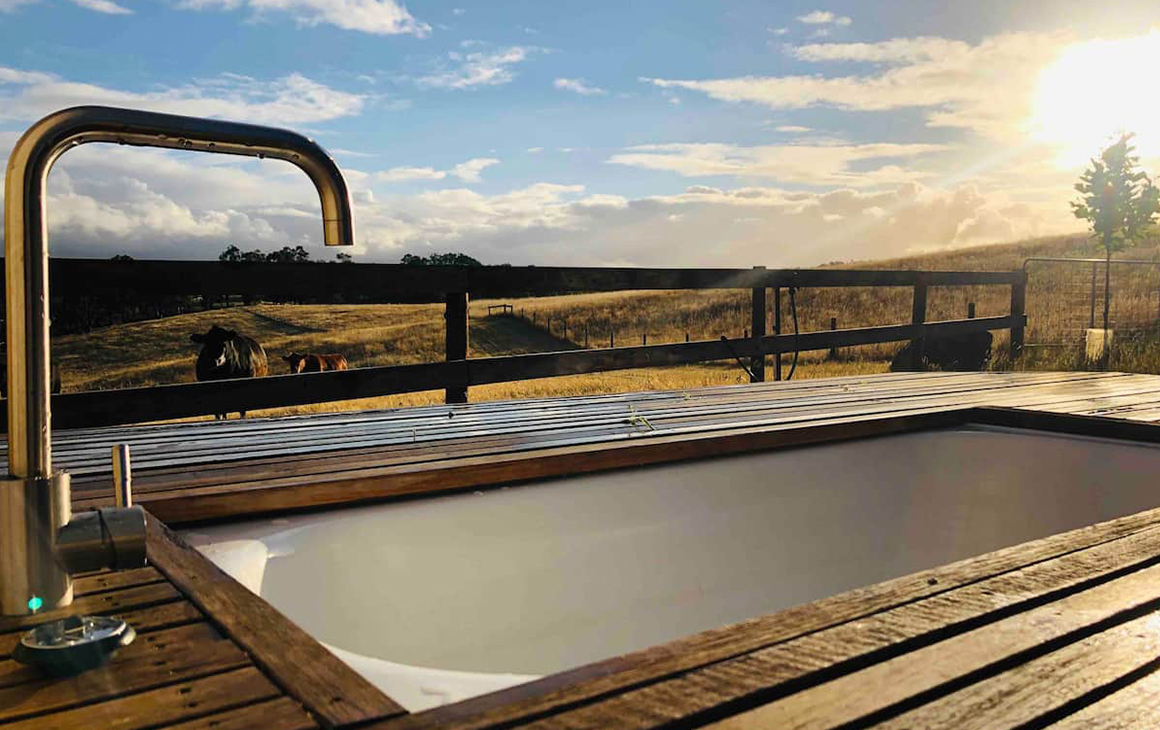 a wooden tub sits in on the edge of Adelaide Hills