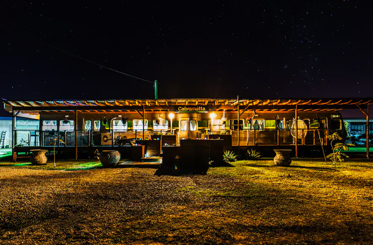 converted train airbnb at night time in australian outback