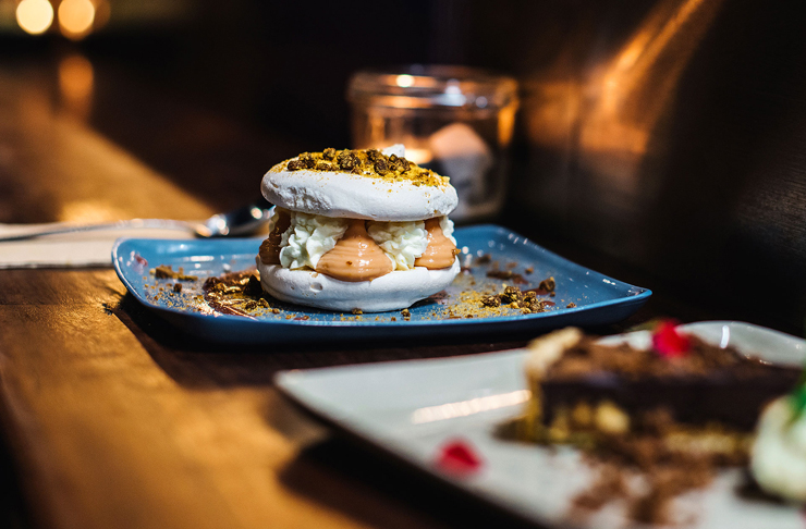meringue burger dessert on bar top