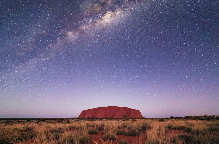 a stunning night at uluru with the milky way sparkling above it