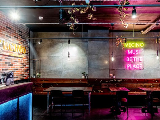 neon lit bar with industrial vibe