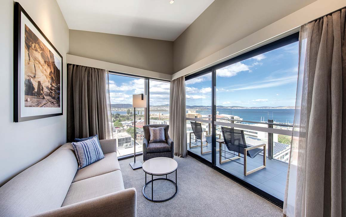 Interior of a suite at the Vibe Hotel, looking out over the Hobart Harbour