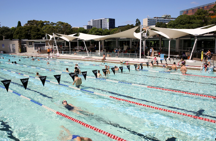 people swimming in open air lap pool