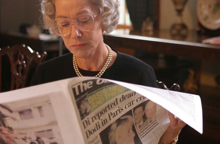 the queen reading the newspaper