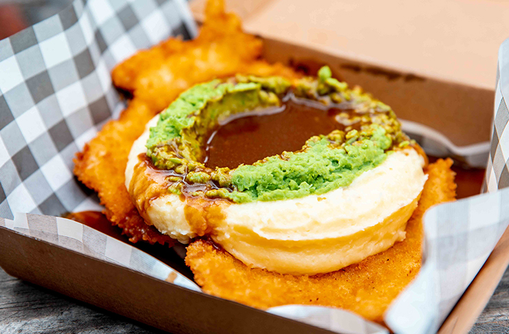 loaded schnitzel with pea mash and gravy