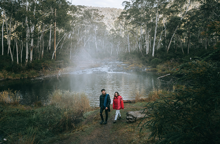 two people walking the the yarangobilly loop in the snowy mountains
