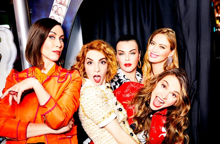 the cast of Younger cuddle up to each other in a photo booth, pulling funny faces
